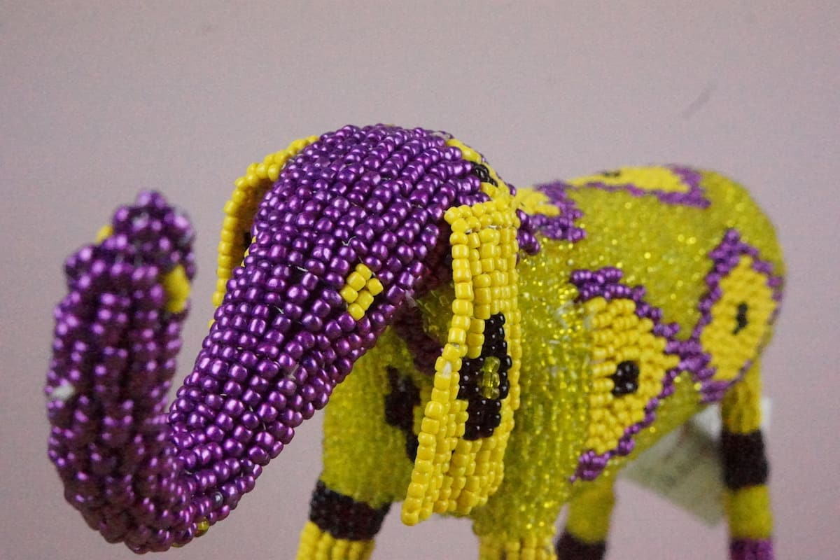 chartreuse yellow and purple glass beaded elephant monkey apple